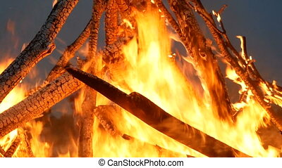 Bonfire. Branches in fire close up. Celebration of folk holiday Kupala Night in Ukraine