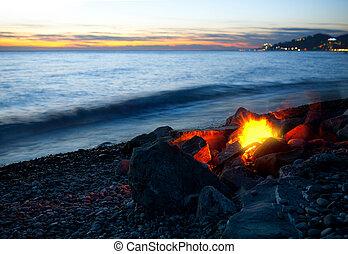 Bonfire on the beach, sunset