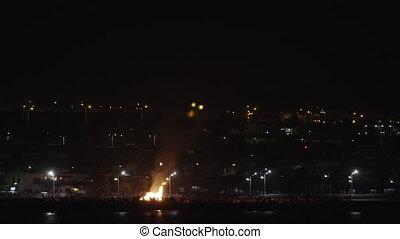 Bonfire on waterfront at San Juan Festival in Lanzarote -...
