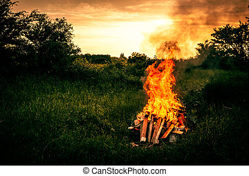 Bonfire scenery - Bonfire at a camp in natural surroundings