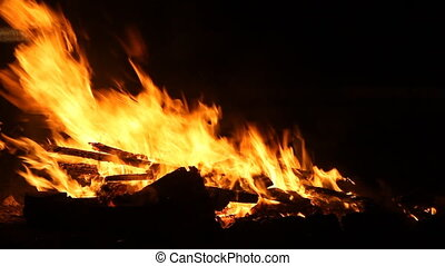 Bonfire burning  on the road in the dark night