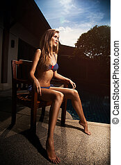 bonito, bronzeado, mulher, em, biquíni, sunbathing