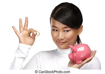 bonito, feliz, chinês, menina, mostrando, um, piggybank