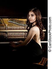 bonito, ficar, mulher, abertos, jovem, costas, escuro, experiência preta, vestido, nere, piano