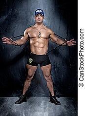 bonito, homem, jovem, muscular, posing.