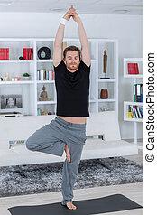 bonito, homem jovem, prática, ioga
