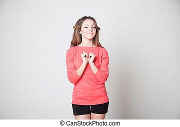 bonito, menina, mostra, mãos, símbolo, coração