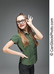 bonito, menina, spectacled, jovem, sorrindo