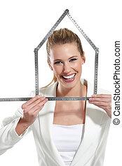 bonito, mulher feliz, mostrando, um, casa, símbolo