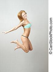 bonito, mulher feliz, pular, swimsuit