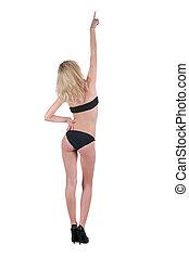 bonito, mulher jovem, apontar, wall., parte traseira, vista.