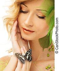 bonito, mulher jovem, em, conceitual, primavera, traje, com, borboleta, ligado, dela, mão