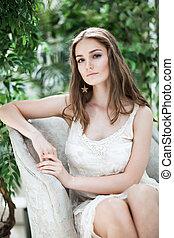bonito, mulher jovem, em, vestido branco