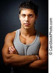 bonito, muscular, homem, com, braços dobraram