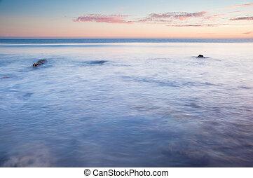 bonito, pôr do sol, sobre, verão, oceânicos, com, pedras, e, vibrante, cores