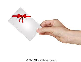 bonito, segurando, cartão presente, isolado, mão, experiência vermelha, branca, arco, fita
