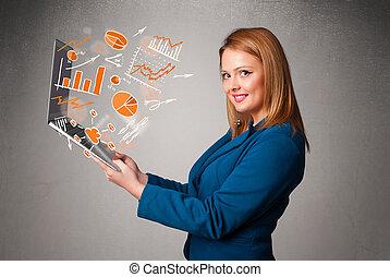 bonito, senhora, segurando, caderno, com, gráficos, e,...