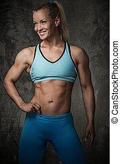 bonito, sorrindo, mulher,  bodybuilder,  Muscular