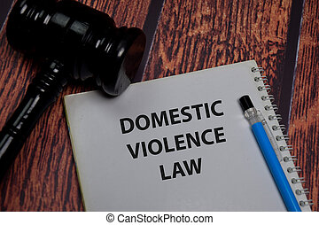 Book about Domestic Violence Law isolated on wooden table.