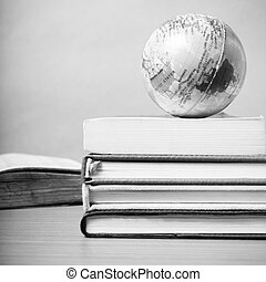 book and earth ball black and white color tone style