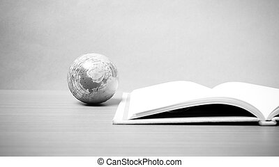 book and earth ball black and white tone style