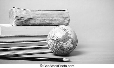 book and earth ball with black pencil black and white color tone style
