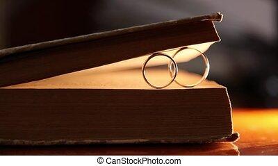 Book and Gold Wedding Rings macro closeup shoot diamon...