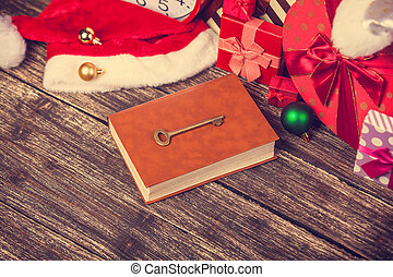 book and key with chirstmas gifts