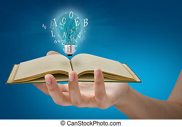 Book and light bulb on hand
