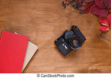 Book autumn background yellow and Red leaves of berries fruits nuts