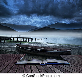 Book concept Stormy sky landscape over misty mountain lake with old boat on lake shore