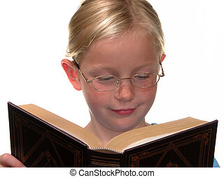 Book Girl - Nine year old girl with glasses reading a large...