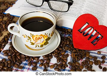 Book glasses and coffee cup