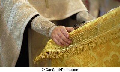 Book in a church. Priest praying ceremony