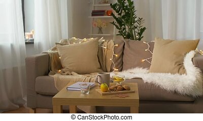 book, lemon, tea and cookies on table at home - cozy home...