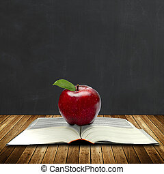 Book of knowledge, apple, chalkboard