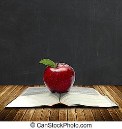 Book of knowledge, apple, chalkboard