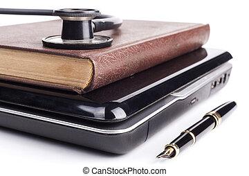 Book on Black Laptop