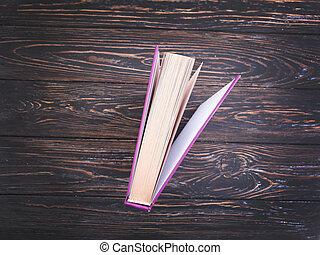 book on old wooden background vintage