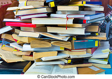 book pile of books - a stack of books in the window of a...