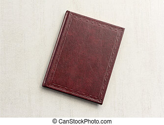 book red on a grey background, top view