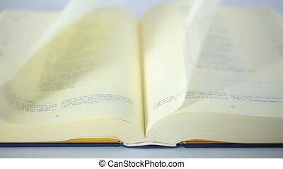 Book scrolling by wind slow