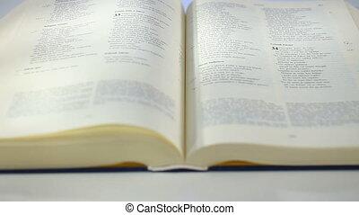 Book scrolling by wind
