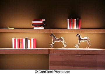 book shelf - books on a shelf in the living room