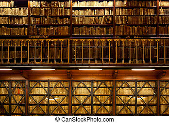 Book shelves in library - Many old books are standing on ...