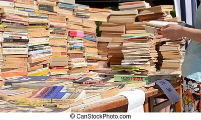 Book Stacks for Sale - Old books stacks for selling. A girl...