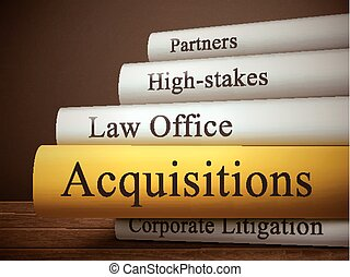 book title of acquisitions isolated on a wooden table over...