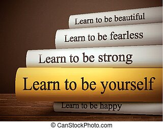 book title of learn to be yourself isolated on a wooden ...