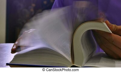 book turn pages quickly man reading library - book turn...