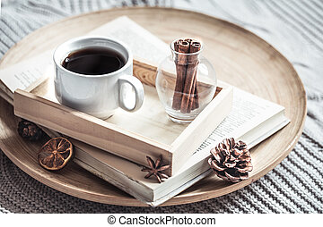 book with a cup of coffee on the bed